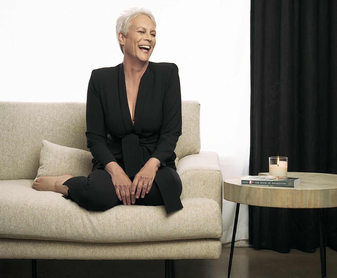 jamie lee curtis laughing in a photo shoot