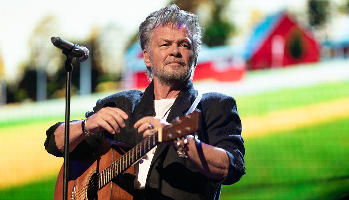 item 5 of Gallery image - John Mellencamp performing in concert at Farm Aid