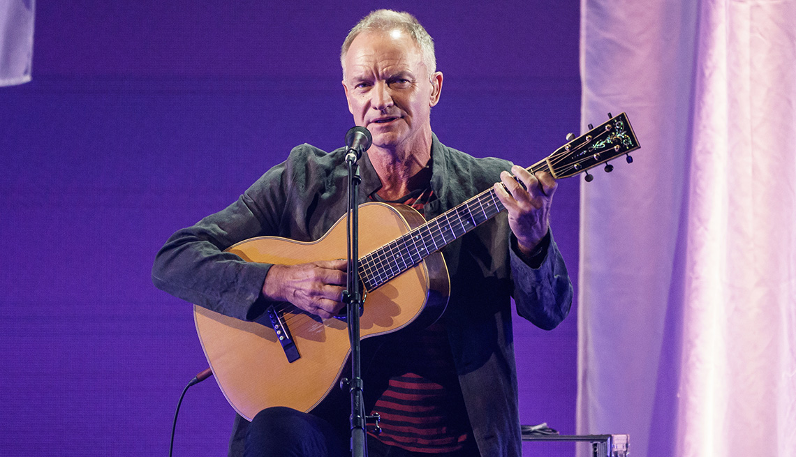 item 1 of Gallery image - Sting playing an acoustic guitar