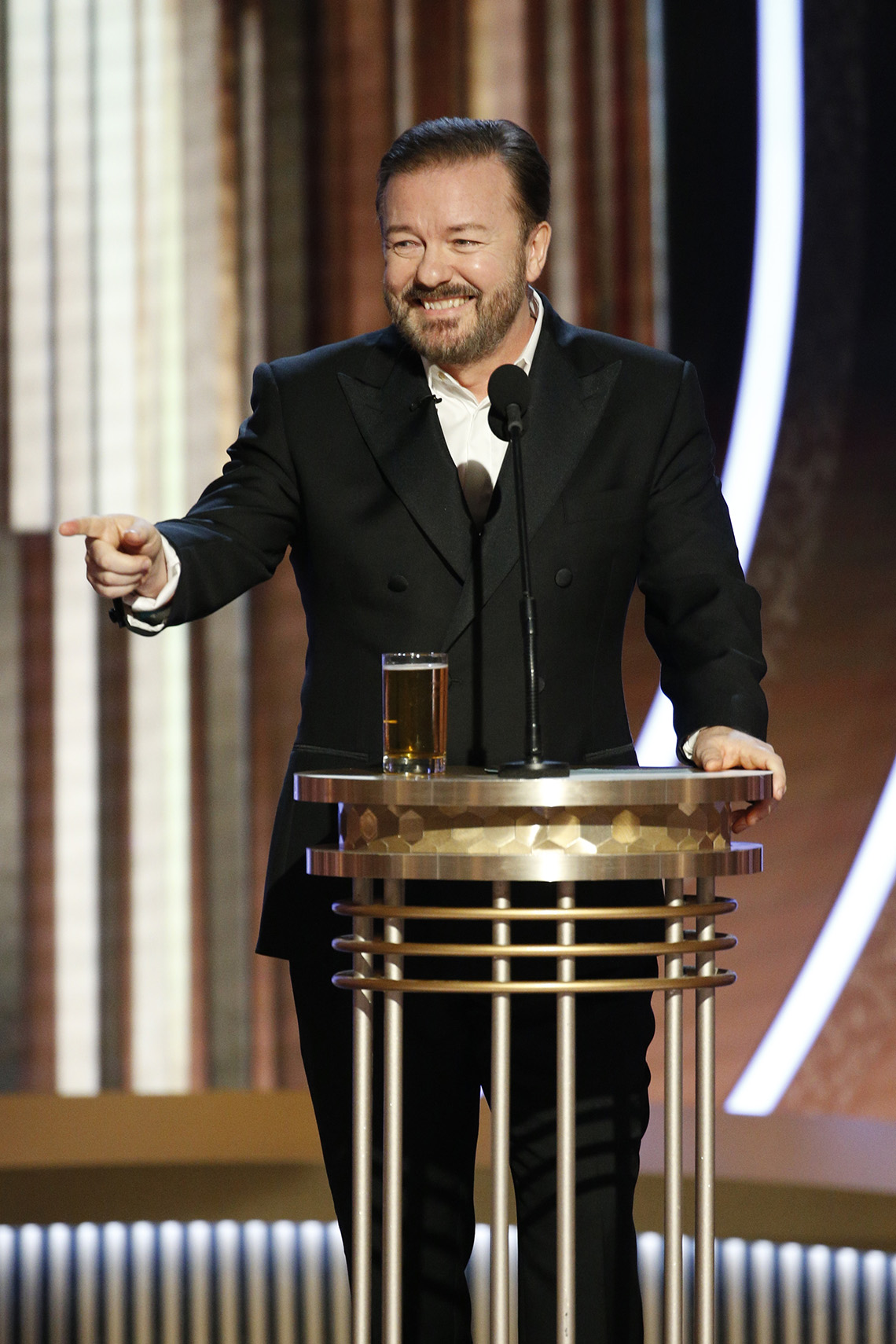 Ricky Gervais onstage hosting the 77th Annual Golden Globe Awards