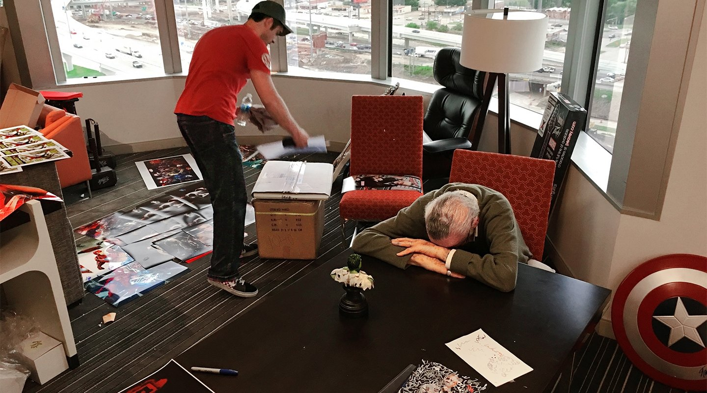 stan lee with head down on desk