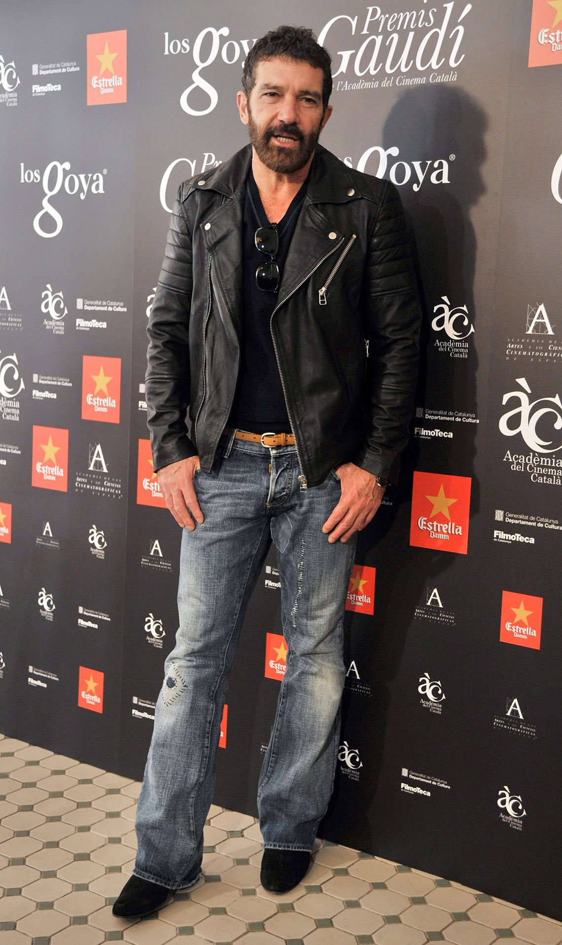 item 7, Gallery image. Antonio Banderas in faded jeans, black leather biker jacket