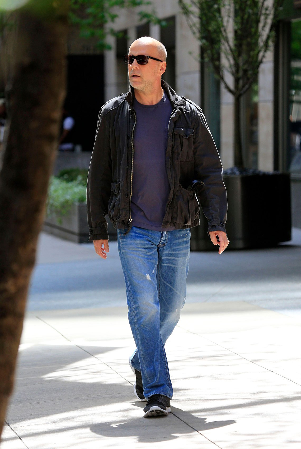 item 6, Gallery image. Bruce Willis in distressed jeans with sneakers and tees and leather jacket