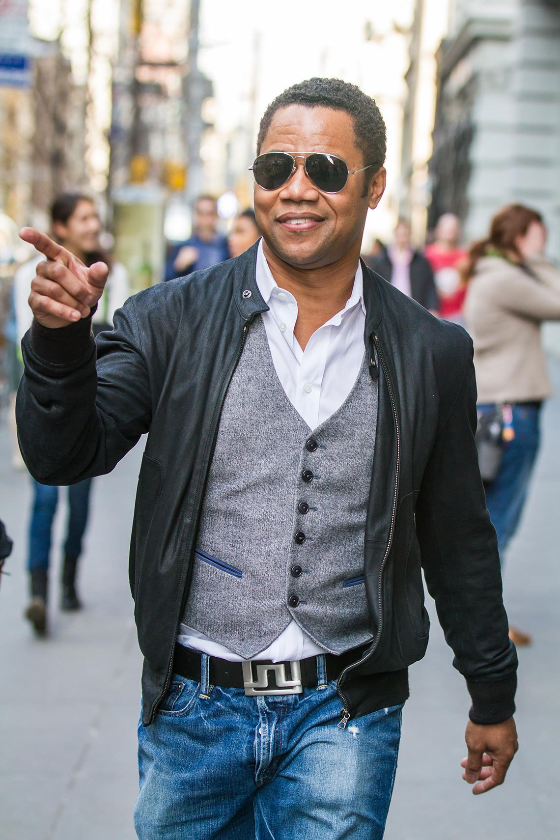item 4, Gallery image. Cuba Gooding Jr. styles up his medium blues with a crisp white shirt, tailored vest and bomber jacket.