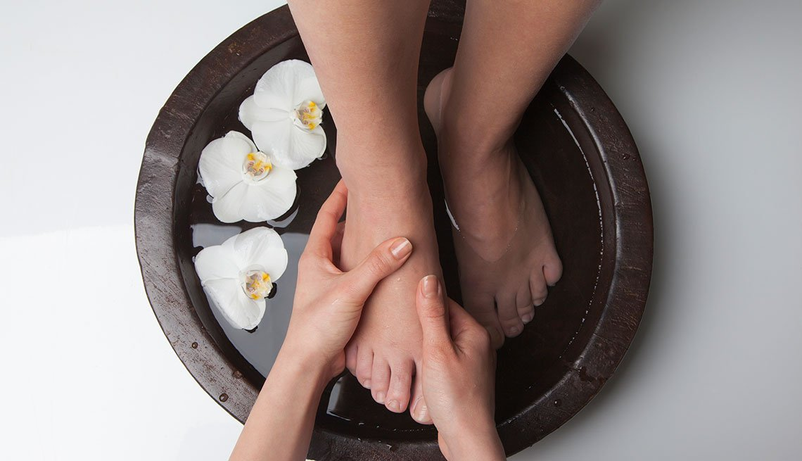 woman at spa getting foot massage