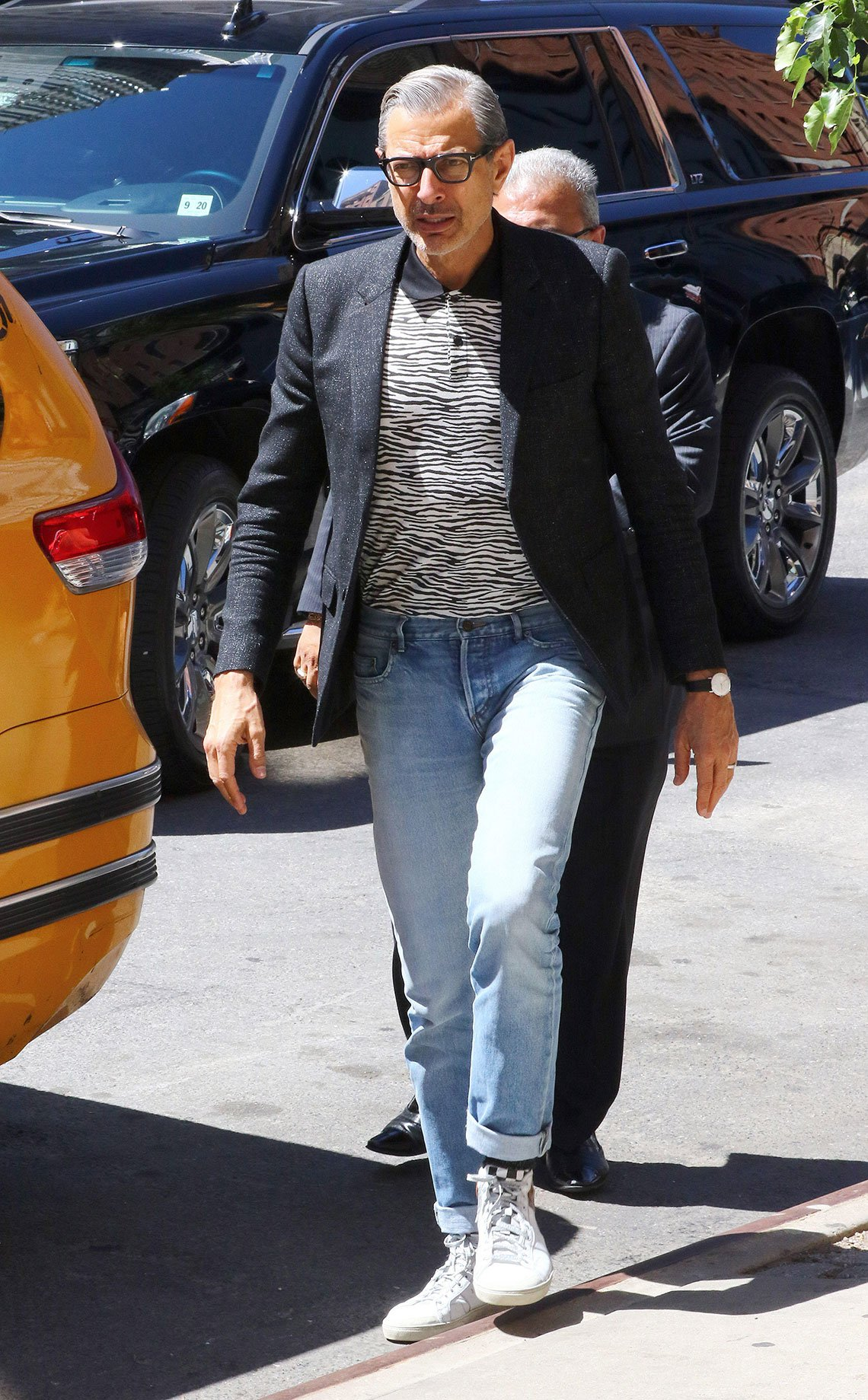 item 8, Gallery image. Jeff Goldblum does a mini-cuff with sneakers and blazer.