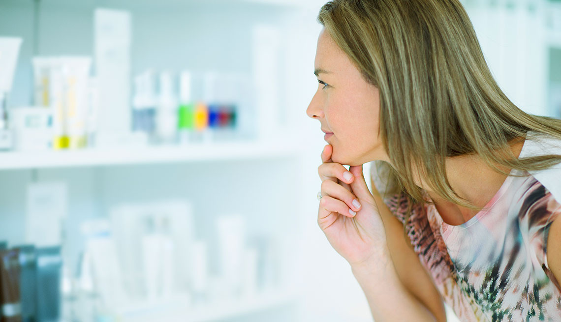 a woman looking at beuaty supplies