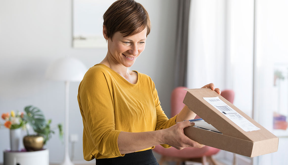 woman looking inside a box