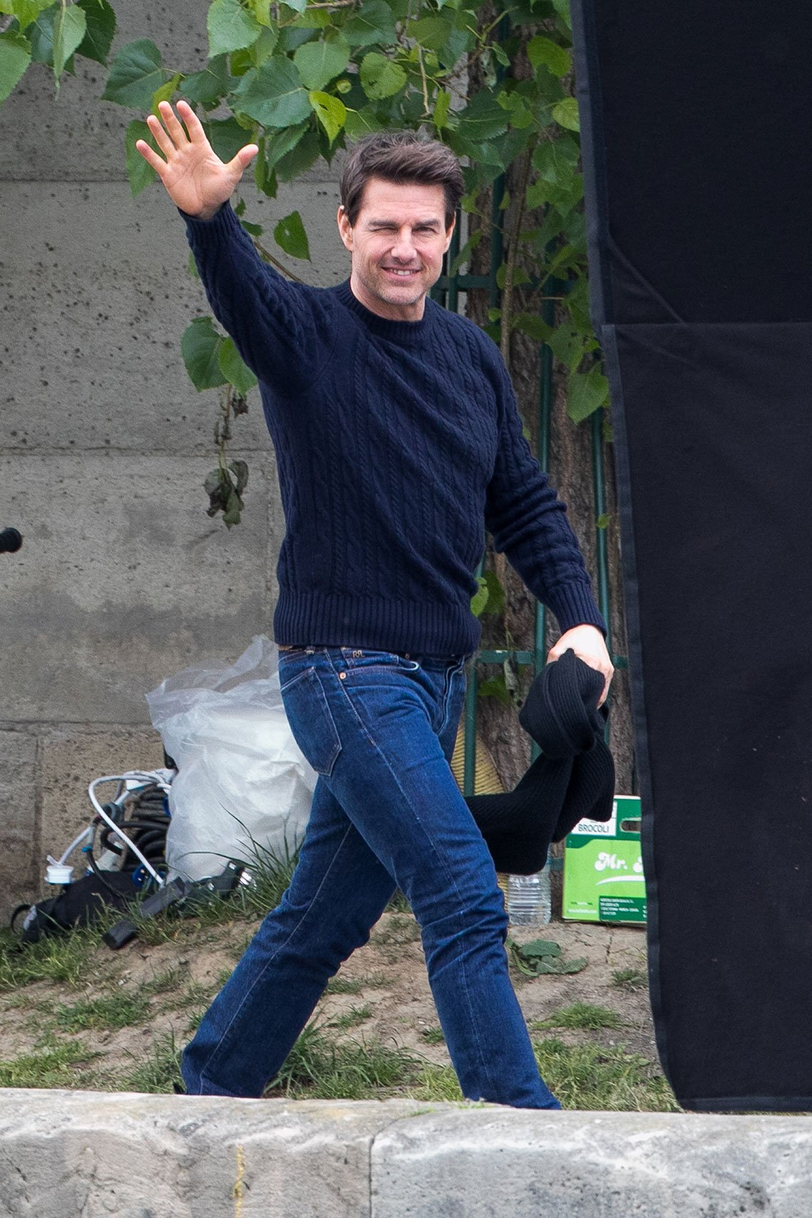 item 10, Gallery image. Tom Cruise in navy cabled crewneck and toned medium blue jeans.
