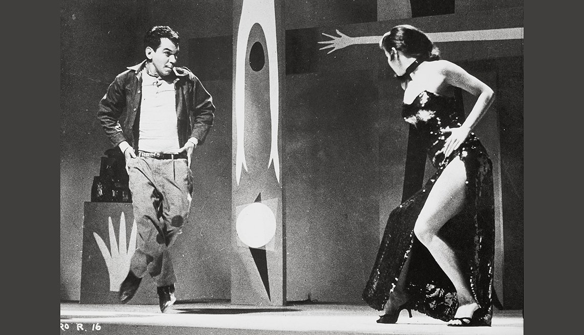 "item 7, Gallery image. Cantinflas and Elaine Bruce in a scene from the 1957 movie ""El Bolero de Raquel"" directed by Miguel M. Delgado."