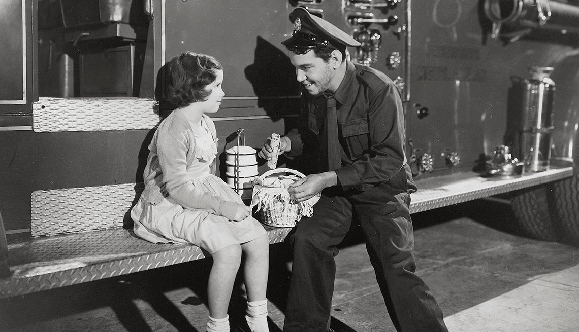 "item 5, Gallery image. Cantinflas and Elisa Quintilla in a scene from the 1952 movie ""El Bombero Atomico"" directed by Miguel M. Delgado."