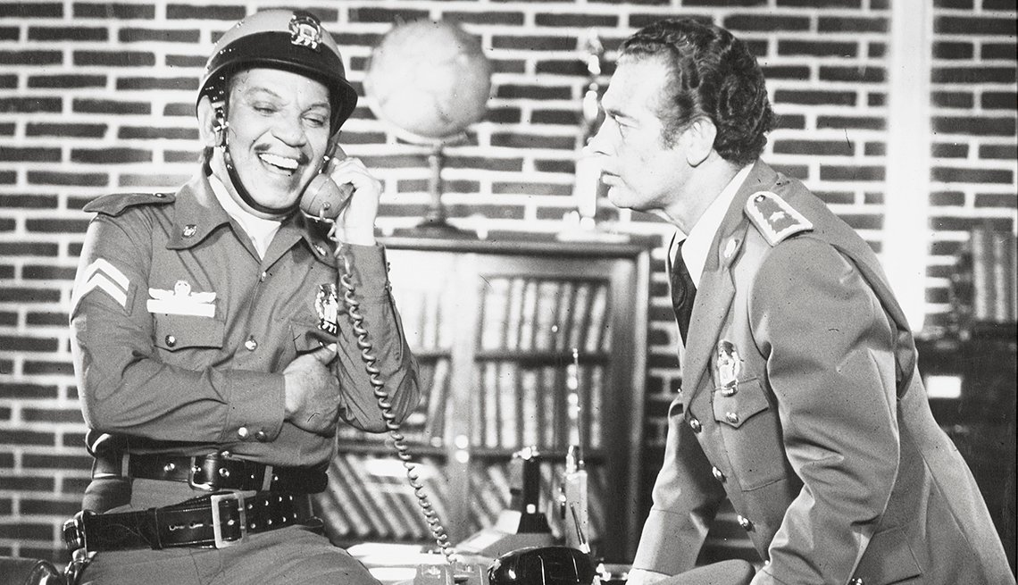 "item 11, Gallery image. Cantinflas and Wolf Rubinski in a scene from the 1978 movie ""El Patrullero 777""directed by Miguel M. Delgado."