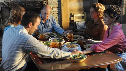 Seven Days in Utopia Movie Review-cast sitting around dinner table