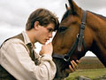 """Albert (Jeremy Irvine) and his horse Joey are featured in this scene from DreamWorks Pictures' """"War Horse"""""""