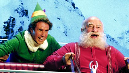 """Will Ferrell as Buddy and Ed Asner as Santa in the film, """"Elf"""""""