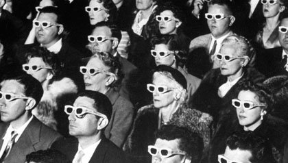 3-D Movie Viewers. Formally-attired audience sporting 3-D glasses during opening night screening of film