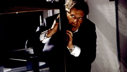 Harrison Ford hiding beside to the table in Air Force One
