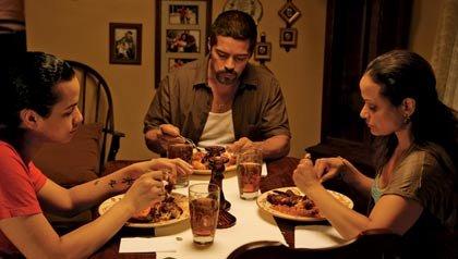 Gun Hill Road – Scene from film of family sitting at dinner table