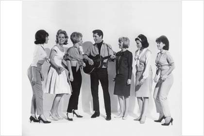 With Elvis Presley and actresses Joan Freeman and Sue Ane Langdon in Roustabout, 1964