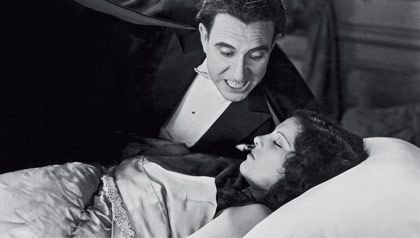 Carlos Villarias, as Dracula, hovers over Lupita Tovar