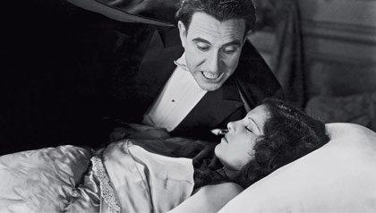 Carlos Villarias, as Dracula, hovers over Lupita Tovar