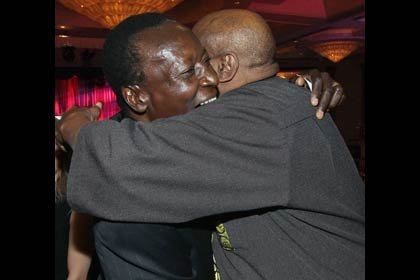 AARP The Magazine's 11th Annual Movies For Grownups Awards - Oliver Litondo hugs Louis Gossett Jr.