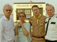 Bill Murray as Mr. Bishop, Frances McDormand as Mrs. Bishop, Edward Norton as Scout Master Ward, and Bruce Willis as Captain Sharp in Wes Anderson's MOONRISE KINGDOM