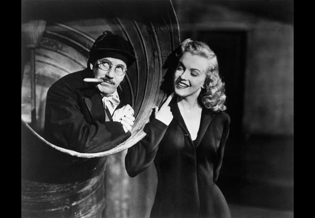 Marilyn Monroe Groucho Marx in a scene from movie Love Happy