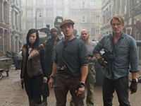 Yu Nan, Sylvester Stallone, Dolph Lundgren, Terry Crews, Randy Couture, back right in THE EXPENDABLES 2