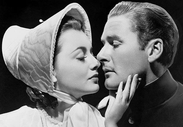 Film stars Errol Flynn and Olivia de Havilland, appearing in several movies together, are seen here embracing in one of their films in 1948. For the best movie couples slideshow.