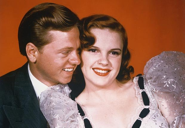 Mickey Rooney and Judy Garland in a publicity photo for the musical Strike Up The Band, in 1940.  For famous movie couples slideshow.
