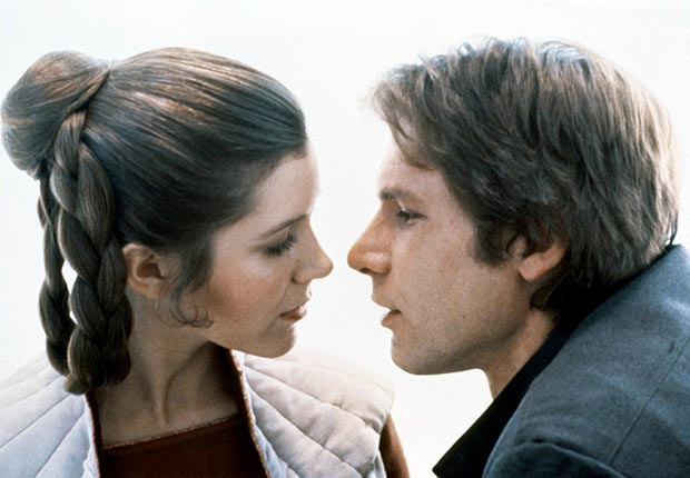 American actors Carrie Fisher and Harrison Ford on the set of Star Wars: Episode V - The Empire Strikes Back in 1980. For Best Movie Couples slideshow.