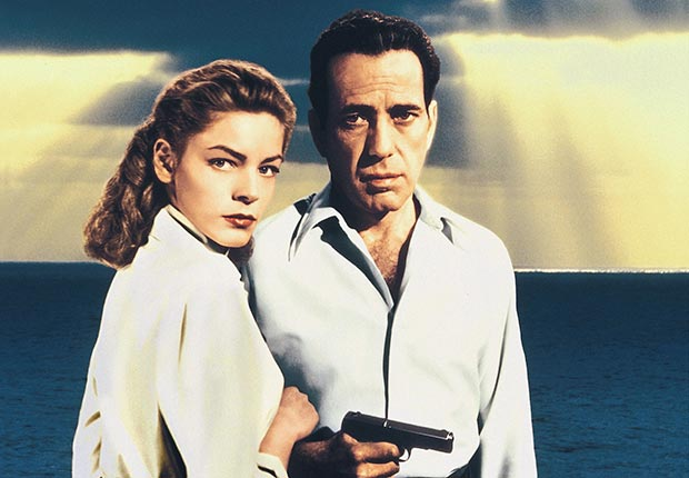Lauren Bacall, as 'Nora Temple', and Humphrey Bogart, as 'Frank McCloud' in a publicity portrait issued for the film, 'Key Largo' in 1948.