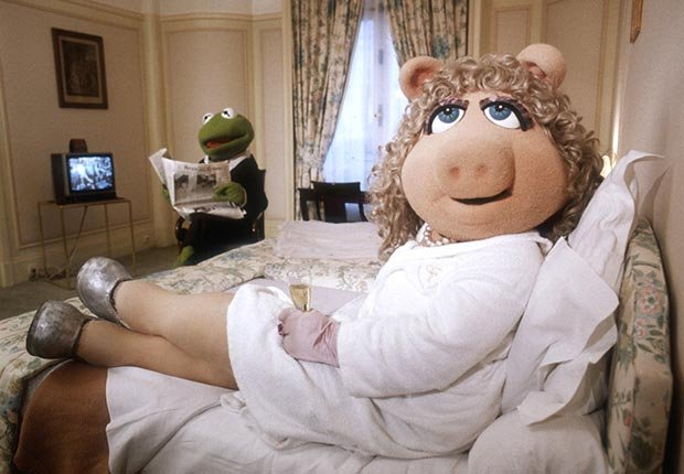 Miss Piggy and Kermit the Frog relax in a hotel room in Paris, France. The Muppet Show debuted in France in 1987. For Best Movie Couples slideshow.