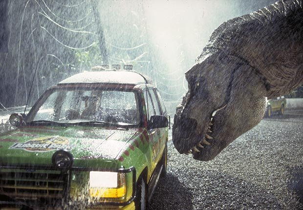 A Tyrannosaurus Rex menaces the theme park's first customers in a scene from the film 'Jurassic Park', 1993.  For the monsters we love slideshow.