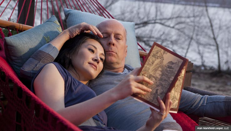 """Summer Qing as """"Joe's Wife"""" and Bruce WIllis as """"Joe"""" in the action thriller LOOPER. For the fall movie preview."""