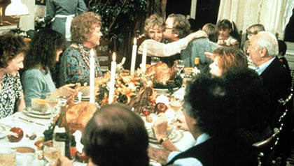 The family gathers at the table for Thanksgiving dinner in Woody Allen's Hannah and Her Sisters, 1986.