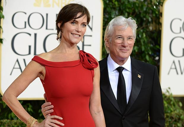 Carey Lowell, left, and Richard Gere arrive at the 70th Annual Golden Globe Awards