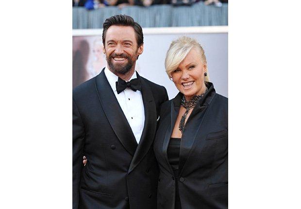 Actors Hugh Jackman, left, and Deborra-Lee Furness arrive at the Oscars