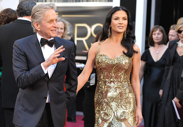 Actors Michael Douglas, left, and Catherine Zeta-Jones arrives at the Oscars