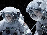 Sandra Bullock and George Clooney in Gravity. Top 10 Movies of 2013.