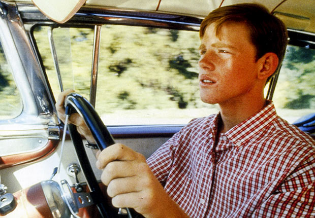Ron Howard as Steve drives in the movie AMERICAN GRAFFITI , Reader poll Boomer Movies