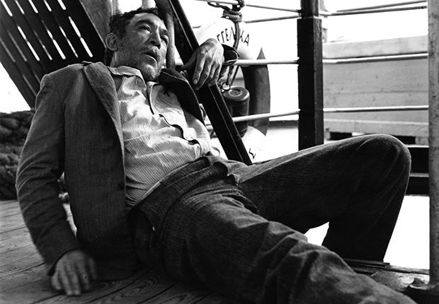 An exhausted Anthony Quinn in a scene from the film 'Zorba, The Greek', 1964.
