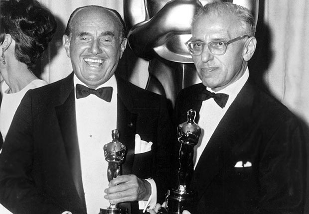 George Cukor, right, with Jack Warner,  hold his Oscar won in 1965  for My Fair Lady.