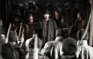 Jamie Bell and Chris Evans star in Snowpiercer.
