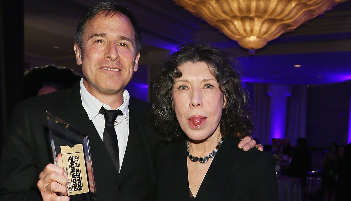 Lily Tomlin sticks out her tongue while posing with screenwriter David O. Russell at the 15th Annual Movies For Grownups Awards