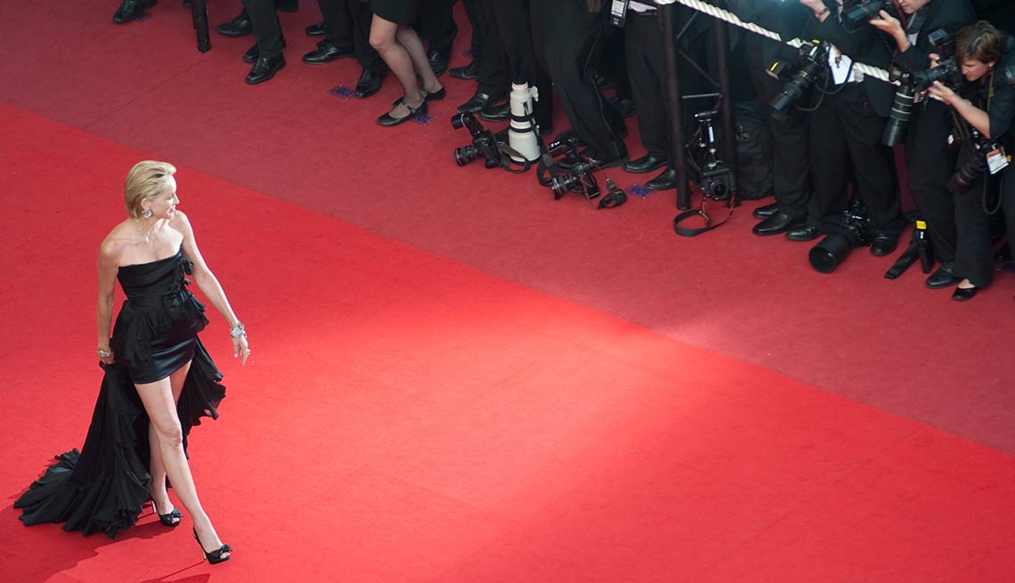 This is a photo from the famous red carpet at the Cannes Film Festival where you can see that all of the paparazzi also wear black tie. I find that to be so chic