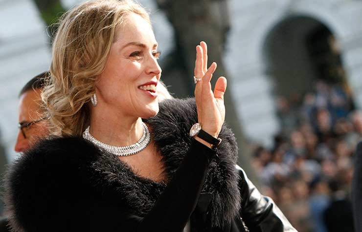 Actress Sharon Stone waves to fans as she arrives for the premiere of 5 Days of August, a drama about the Russia-Georgia conflict in Tbilisi, Georgia