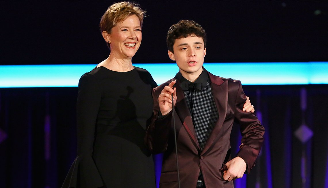 Presenters Annette Bening, left, and Lucas Jade Zumann speak onstage