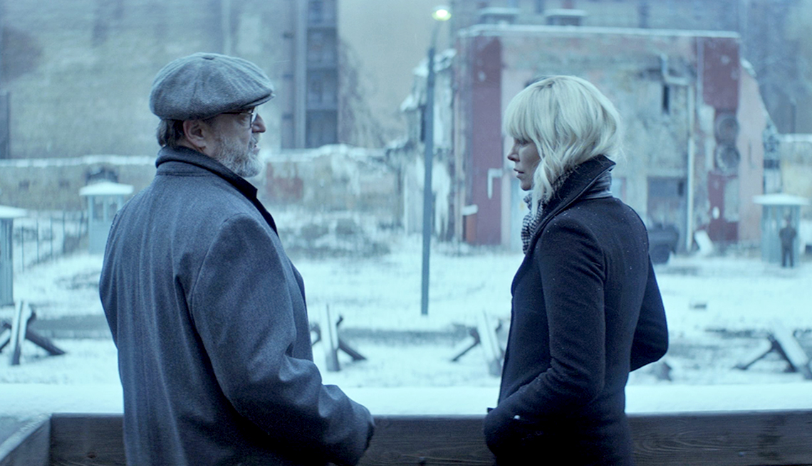 John Goodman and Charlize Theron in 'Atomic Blonde'
